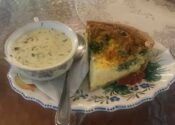 Slice of quiche and a cup of soup
